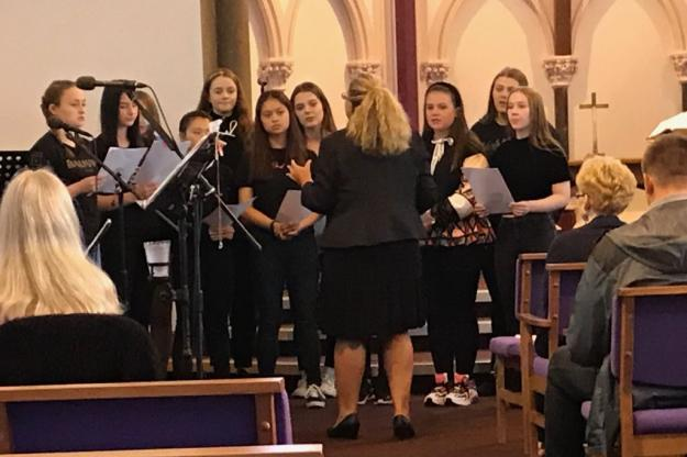 Students Perform at Marie Curie Service